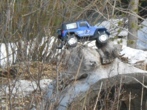 One of my grandsons' toy cars (or is that jeep?). As soon as the snow starts to melt, the kids start dragging toys outside.