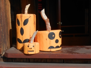 On a fall road trip, I spent a couple traveling through Wyoming. In a little (as in very little) town call Centennial, these jack-o-lanterns were on the porch outside a delightful western restaurant (